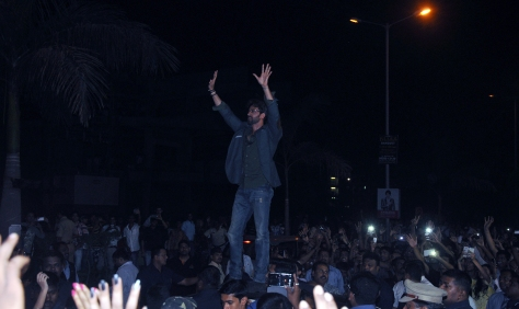 Hrithik Roshan interacts with his fans from atop his car at the Joyalukkas Vashi store launch